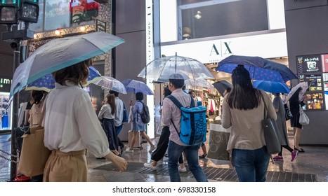 TOKYO, JAPAN - AUGUST 16TH, 2017. View of people in Shinjuku street during a rainy night.