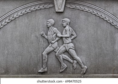 TOKYO, JAPAN - August 17, 2017: Relief of atheletes on Gorin Bridge (Five Ring Bridge), a bridge between Harajuku Station and Yoyogi National Gymnasium, a 1964 Olympic venue and 2020 handball venue.