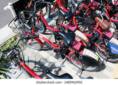 TOKYO, JAPAN - August 17, 2019: Electric bikes belonging to Toyko's public bicycle sharing scheme parked on sidewalk in Tokyo's Chuo Ward's Kyobashi area.