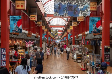Tokyo, Japan - August 17 2019: Crowded streets in Asakusa area near the Senso-ji temple during holiday season. A perfect place to see the culture on a sunny day in Japan!