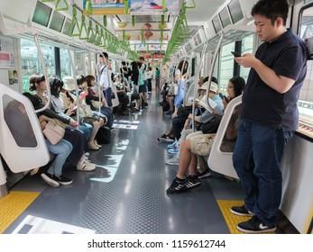TOKYO, JAPAN - AUGUST 17TH, 2018.  Commuters in a Japan Railway passenger train.