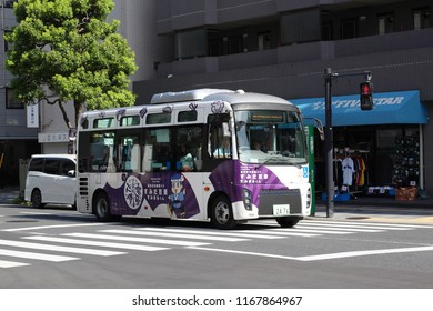 TOKYO, JAPAN - August 18, 2018: A Sumida City Loop Bus in operation on Hokusai Dori in Tokyo's Sumida Ward.