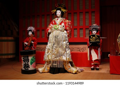 TOKYO, JAPAN - August 18, 2018:  Figures on a stage which of part of a Kabuki exhibit at Tokyo's Edo-Tokyo museum.