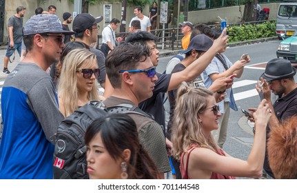 TOKYO, JAPAN - AUGUST 19TH, 2017. Tourists taking picture at Takeshita street in Harajuku.
