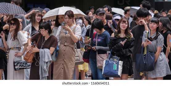 TOKYO, JAPAN - AUGUST 19TH, 2018.  Pedestrian waiting to cross the street in Shibuya.