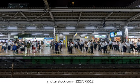 Tokyo, Japan - August 2018: Crowd of people waiting for the subway in lines in Tokyo, Japan
