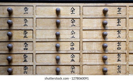 Tokyo, Japan - August 2018: Frontal close up view of drawers for Omikuji - Paper Fortune at Sensoji Asakusa Kannon Temple