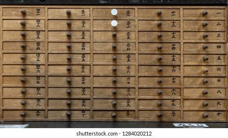 Tokyo, Japan - August 2018: Lockers used for bad fortune telling, Omikuji at Asakusa Kannon temple, Asakusa, Tokyo, Japan