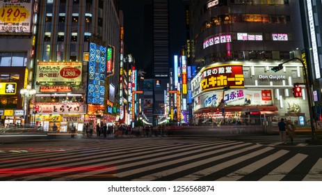 Tokyo, Japan - August 2018: Long exposure photo of people at Kabukicho in the Shinjuku district. The area is an entertainment and red-light district