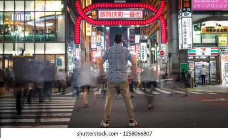 Tokyo, Japan - August 2018: Long exposure photo of an unidentified man standing at Kabukicho in the Shinjuku