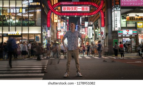 Tokyo, Japan - August 2018: Long exposure photo of a tourist standing at a crossroads in Kabukicho in the Shinjuku