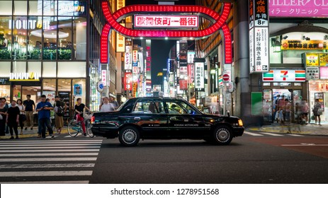 Tokyo, Japan - August 2018: Long exposure photo of a taxi at a crossroads in Kabukicho in the Shinjuku