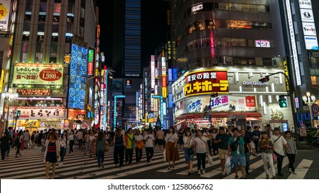 Tokyo, Japan - August 2018: Night scene from Kabukicho district in Shinjuku with bright lights and people walking