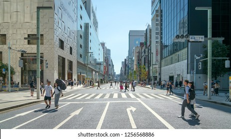 Tokyo, Japan - August 2018: Shopping district Ginza with famous Chuo Dori street that closes to cars on Sundays and becomes a pedestrian street