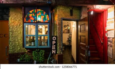 Tokyo, Japan - August 2018: Traditional street bars in Shinjuku Golden Gai district at night. Golden gai district has around 200 tiny bars