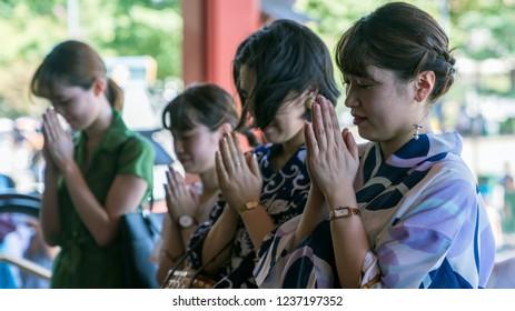 Tokyo, Japan - August 2018: Unidentified people praying at Sensoji Temple, the oldest temple in Asakusa area Tokyo, Japan