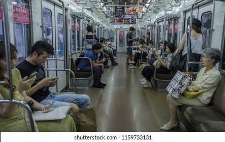 TOKYO, JAPAN - AUGUST 20TH, 2018.  Commuters in a Tokyo Metro subway train.