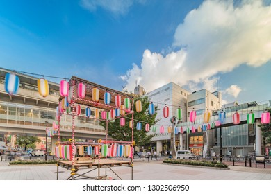 TOKYO, JAPAN - August 23 2018: View of the square in front of the Nippori train station decorated for the Obon festival in the summer with a yagura tower and paper lanterns in Tokyo.
