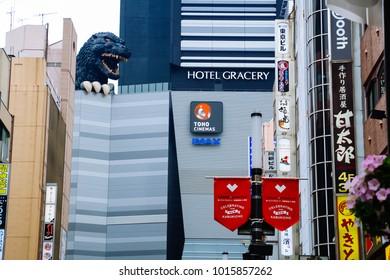 TOKYO, JAPAN - August 25, 2015: Pedestrians walk at Kabukicho district. Godzilla in shinjuku