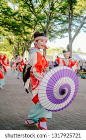 TOKYO, JAPAN - AUGUST 25 2018: Japanese performers dancing in the famous Harajuku Genki Matsuri Super Yosakoi festival, a yearly free public event. Yosakoi is a unique style of Japanese dance.