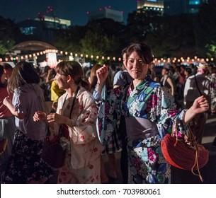 TOKYO, JAPAN - AUGUST 25TH, 2017. Crowd of people dancing at a Bon Odori festival in Hibiya Park.