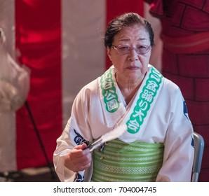 TOKYO, JAPAN - AUGUST 25TH, 2017. Elderly Japanese woman in traditional yukata dress at Bon Odori festival in Hibiya Park.