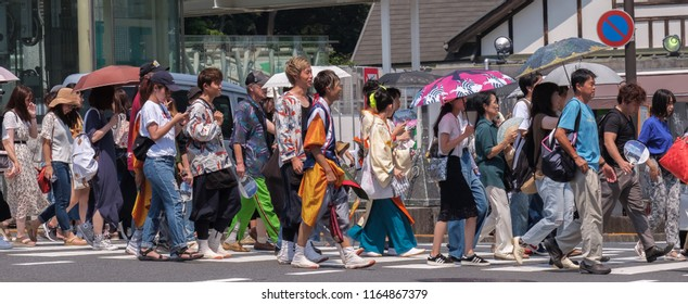 TOKYO, JAPAN - AUGUST 25TH, 2018. Crowd of people crossing the street in front of Harajuku Railway Station.