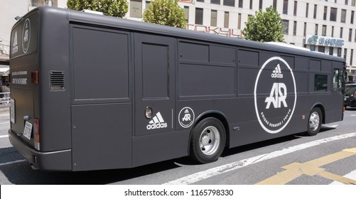 TOKYO, JAPAN - AUGUST 25TH, 2018. Adidas Runners running movement campaign advertisement bus making it rounds in Shibuya street.