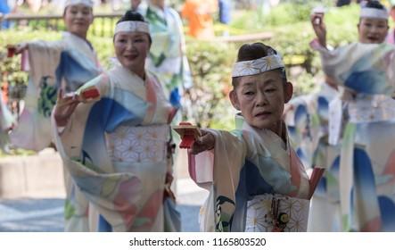 TOKYO, JAPAN - AUGUST 25TH, 2018. Elderly woman dancer performing her routines at  Harajuku Omotesando Genki Matsuri Super Yosakoi dance festival in  Omotesando street.