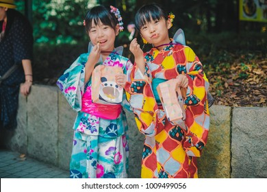 TOKYO, JAPAN - AUGUST 26 2017 - a documentary photo of two girls from the Harajuku Genki Matsuri Super Yosakoi - a festival that combines traditional Japanese dance movements with modern music.