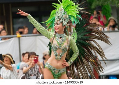 Tokyo, Japan - August 26, 2017 :  Female participant wearing a gorgeous costume dancing on the street at the 36th Asakusa Samba Carnival.