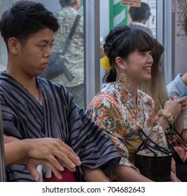 TOKYO, JAPAN - AUGUST 26TH, 2017. Japanese commuters in traditional yukata in Tokyo Metro subway train.