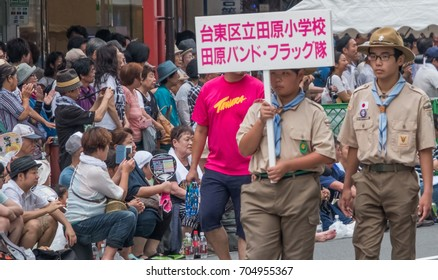 TOKYO, JAPAN - AUGUST 26TH, 2017. Sign carriers at the Asakusa Samba Carnival Parade in Tokyo.
