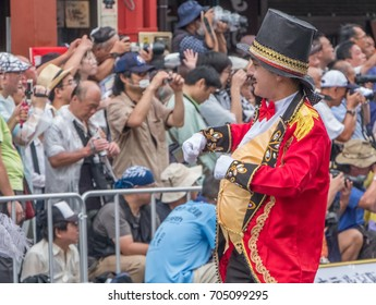 TOKYO, JAPAN - AUGUST 26TH, 2017. Dancers in fancy costume in Asakusa Samba Carnival Parade in Tokyo.