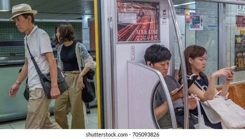 TOKYO, JAPAN - AUGUST 26TH, 2017.Commuters in a Tokyo Metro subway train.