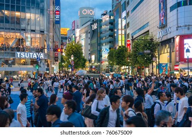 Tokyo, Japan - August 30, 2016: Crowd of people on famous Shibuya pedestrian crossing at night