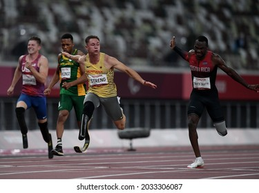 TOKYO, JAPAN - AUGUST 30: Gold medalist Felix Streng (Second R)of Team Germany reacts after competing in the men's 100m - T64 final on day 6 of the Tokyo 2020 Paralympic Games at Olympic Stadium.