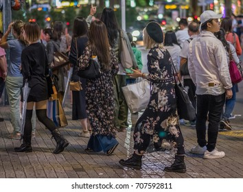 TOKYO, JAPAN - AUGUST 31ST, 2017. People in the streets of Shibuya at night.