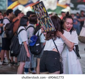 TOKYO, JAPAN - AUGUST 4TH, 2017. Young people offering free hugs in Shibuya.