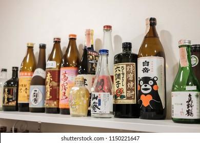 TOKYO, JAPAN - AUGUST 6TH, 2017. Many sake bottles on display inside a shop in restuarant
