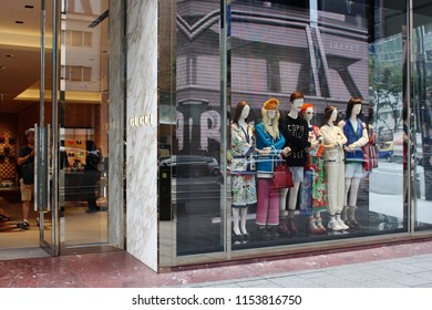 TOKYO, JAPAN - August 9, 2018: The entrance and striking window display of a Gucci store in Toyko's Ginza area.