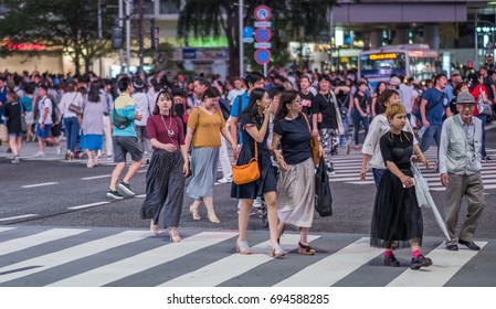 TOKYO, JAPAN - AUGUST 9TH, 2017.  Crowds of people at the famous Shibuya street scramble crossing at night.