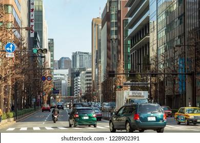 TOKYO, JAPAN - CIRCA, 2018: Cars in traffic on the street of Tokyo, Japan