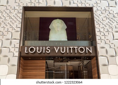 Tokyo, Japan - CIRCA 2018: The company's logo is seen outside Tokyo's Louis Vuitton store. LV, is a French fashion house and luxury retail company founded in 1854 by Louis Vuitton.