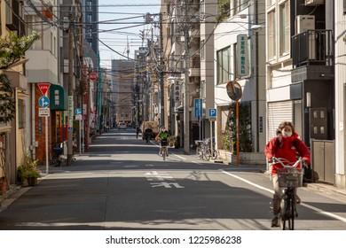 TOKYO, JAPAN - CIRCA, 2018:  People walking on the street in Tokyo, Japan