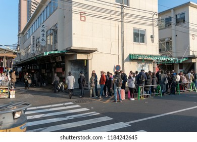 Tokyo, Japan - CIRCA 2018: Tsukiji fish market is the largest wholesale fish and seafood market in the world. People queuing outside the seafood restaurants