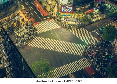 TOKYO, JAPAN - CIRCA APRIL 2017: Pedestrian scramble crosswalk in Shibuya, Tokyo at night. It is famous to be one of the busiest crosswalks in the world