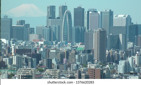 TOKYO,  JAPAN - CIRCA APRIL 2019 : Aerial view of CITYSCAPE of TOKYO around Shinjuku city and mount fuji.  View from Bunkyo ward.