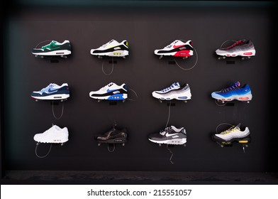 TOKYO, JAPAN - CIRCA August, 2014:  Nike brandded sneakers on display in Shibuya street. Shibuya street is a shopping center in Tokyo lined with brand names.
