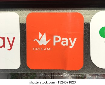 """TOKYO, JAPAN - CIRCA FEBRUARY 2019 : SIGN of """"ORIGAMI PAY"""" at the shop in Tokyo."""